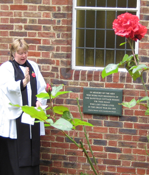 Rev Jane Cresswell blessing the new plaque